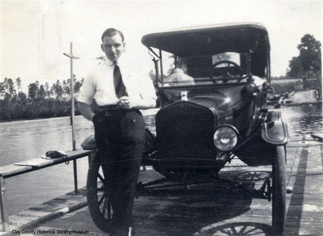 Ferries Rideout (1917) man standing in front of a Model T