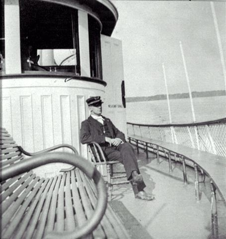 Captain H. D. DeGrove on a steamboat